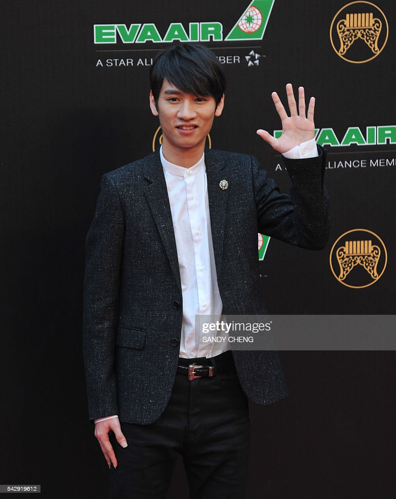 Taiwanese singer Kowen Ko arrives to attend the 27th Golden Melody Awards in Taipei on June 25, 2016. Some of Mandarin pop's biggest names have gathered for the annual Golden Melody music awards, with singers, songwriters and composers from Taiwan, China, Hong Kong, Singapore and Malaysia competing in more than 20 categories. / AFP / SANDY