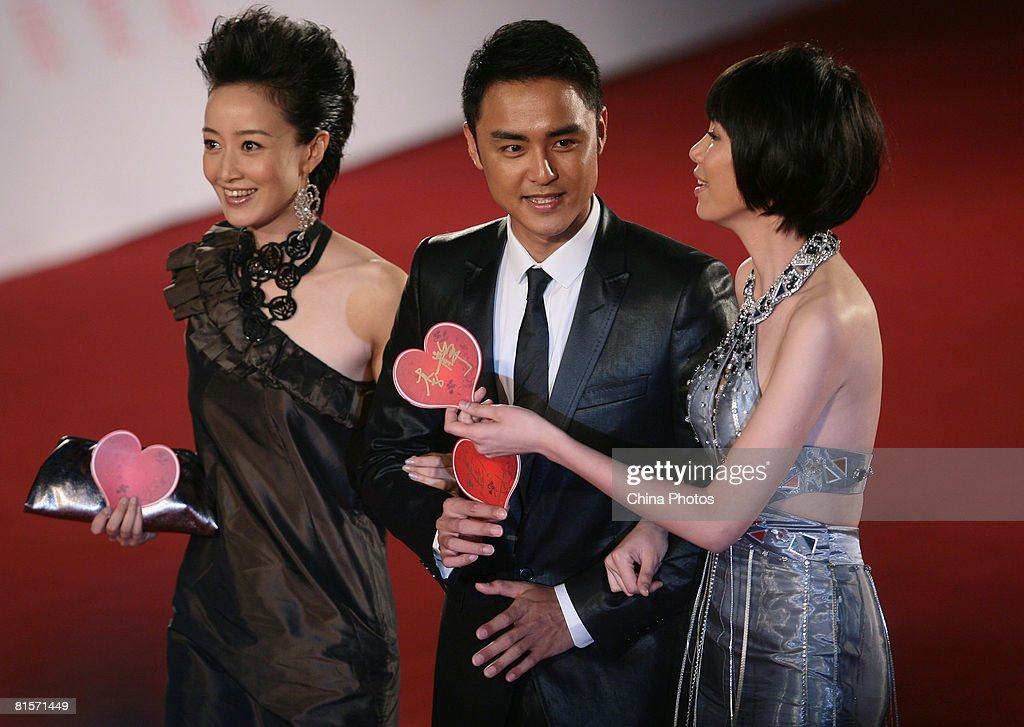 Taiwanese singer Ming Dao holding a heart shape showing support for the earthquakestricken area of Sichuan arrives to attend the opening ceremony of...