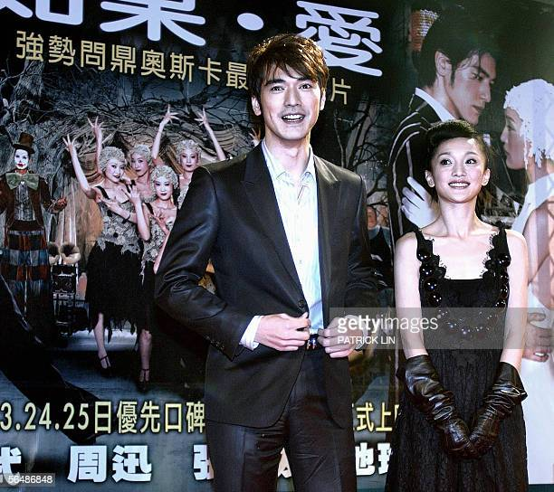 Taiwanese star Takeshi Kaneshiro and Chinese actress Zhou Xun pose during the promotion of the new musical film 'Perhaps Love' in Taipei 25 December...
