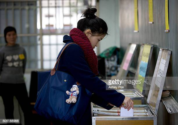 Taiwanese woman votes at a polling staion on January 16 2016 in Taipei Taiwan Voters in Taiwan are set to elect Tsai Ingwen the chairwoman of the...