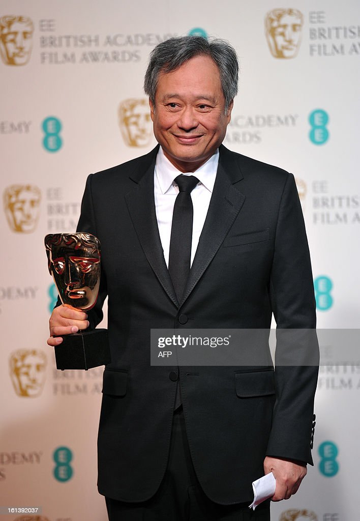Taiwanese-born US film director Ang Lee poses with the Cinematography award for Claudio Miranda for his work on the film Life of Pi during the annual BAFTA British Academy Film Awards at the Royal Opera House in London on February 10, 2013. AFP PHOTO / CARL COURT