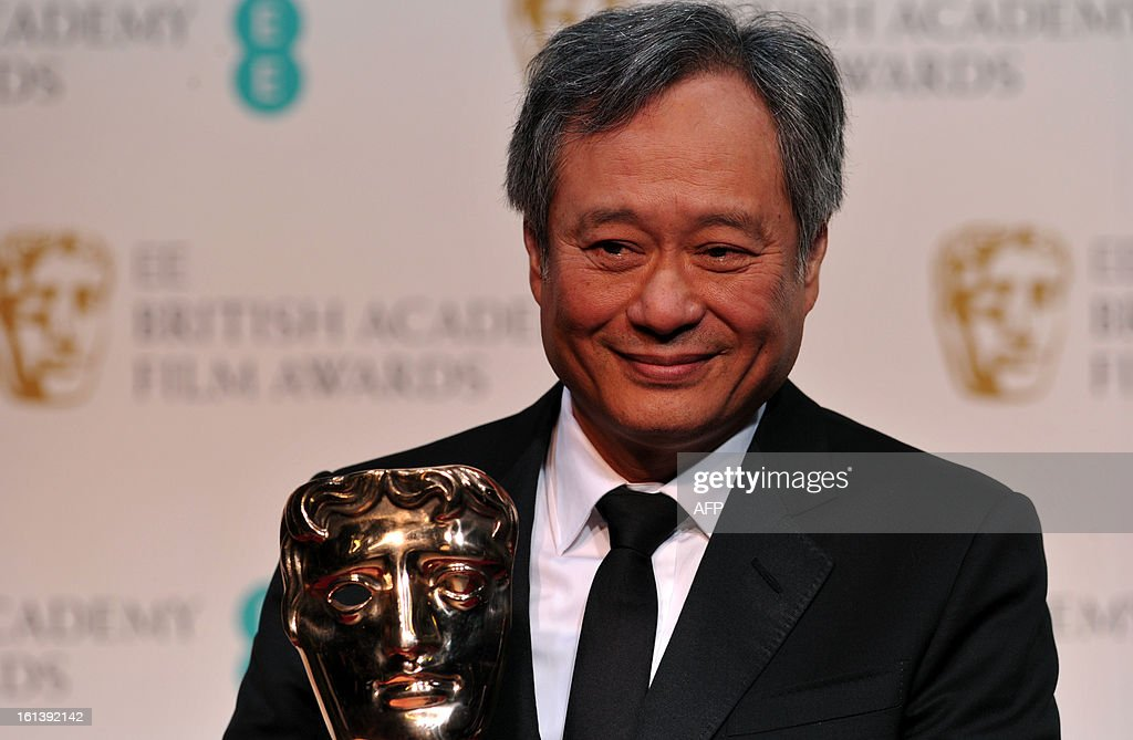 Taiwanese-born US film director Ang Lee poses with the Cinematography award for Claudio Miranda for his work on the film Life of Pi during the annual BAFTA British Academy Film Awards at the Royal Opera House in London on February 10, 2013.