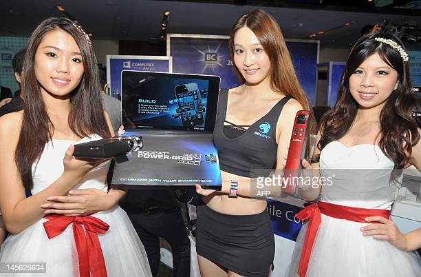 TaiwanITtechnologyshowADVANCER by Benjamin Yeh This photo taken on May 29 2012 shows promotion girls displaying information technology products...