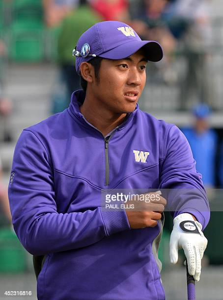 Taiwan's amateur golfer Pan Chengtsung watches his shot from the 4th tee during his second round on day two of the 2014 British Open Golf...