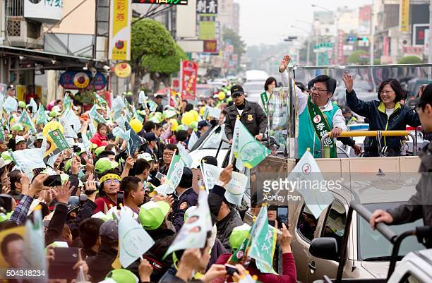 Taiwan's Democratic Progressive Party presidential candidate Tsai Ingwen greets supporters from a truck as she parades through the streets on January...