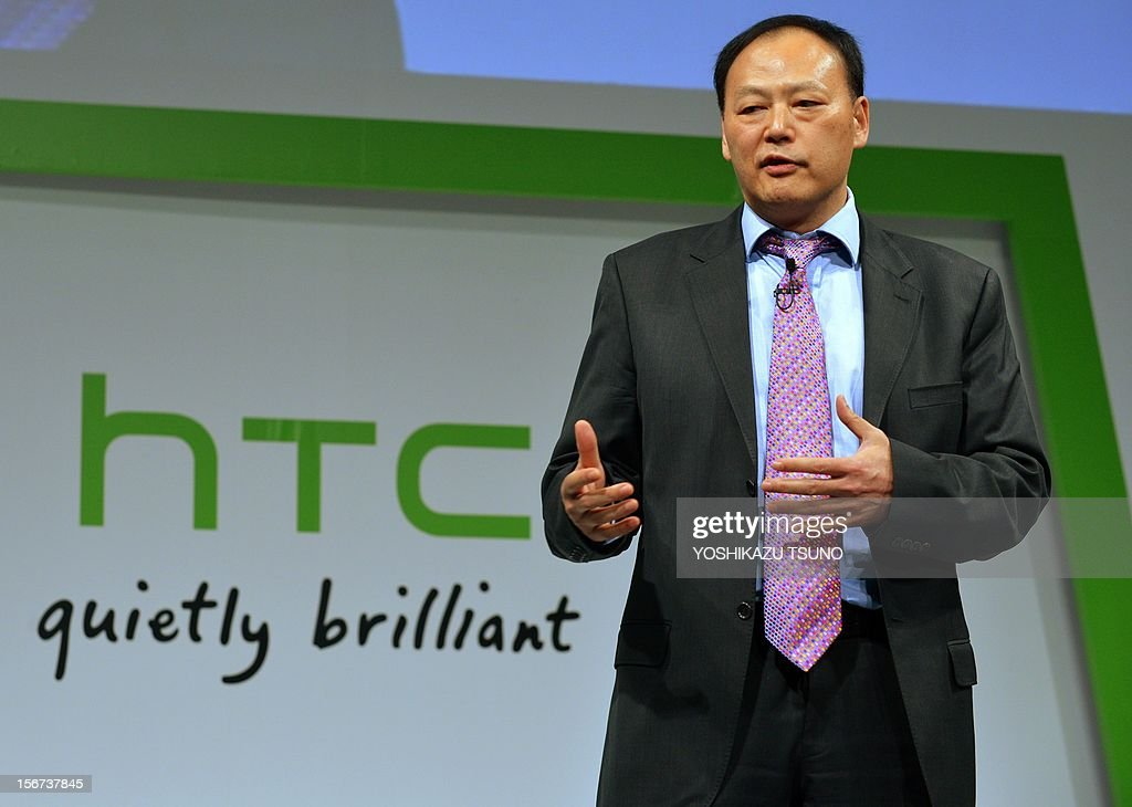 Taiwan's electronics giant HTC CEO Peter Chou introduces the new smartphone 'HTCJ butterfly' for Japanese mobile carrier KDDI in Tokyo on November 20, 2012. The new smartphone has a quad-core CPU, 5-inch sized high-definition LCD display and an 8 mega-pixel CMOS camera on its slim body. AFP PHOTO / Yoshikazu TSUNO