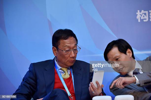 Taiwan's Foxconn Technology chairman Terry Gou and Xiaomi Inc CEO Lei Jun attend the CrossStrait Hong Kong and Macau Internet Development Forum of...
