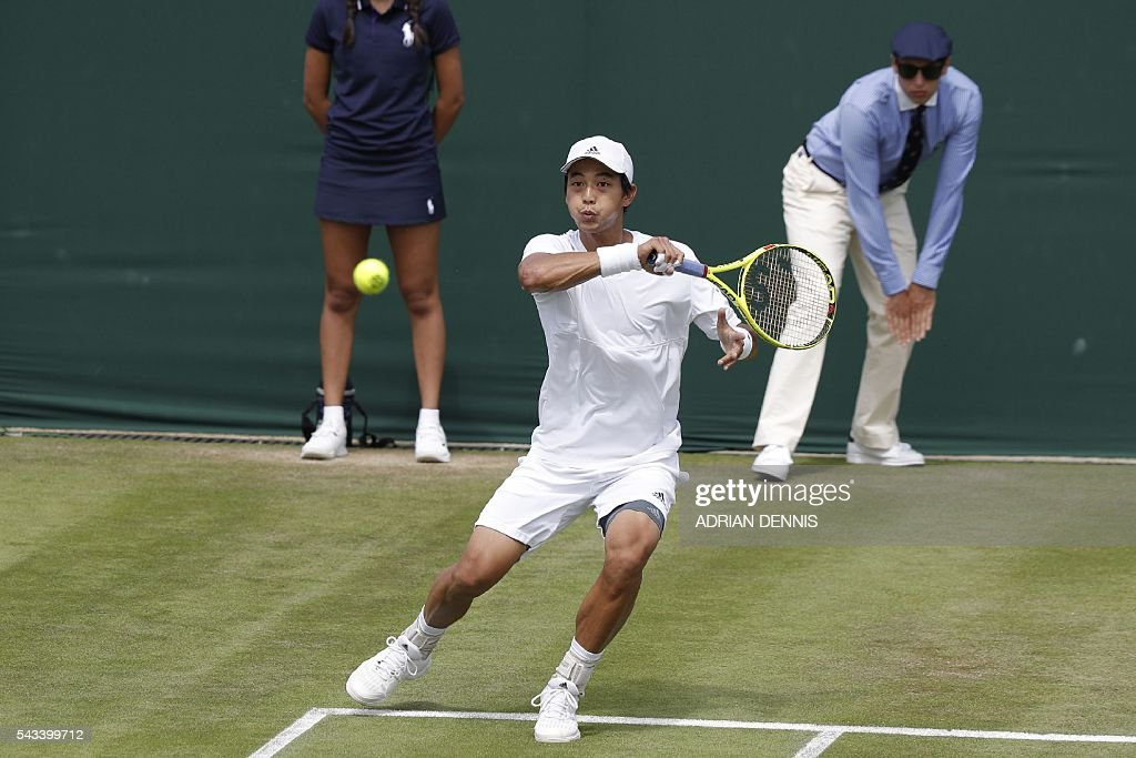 Taiwan's Lu Yen-Hsun serves against Russia's Alexander Kudryavtsev during their men's singles first round match on the second day of the 2016 Wimbledon Championships at The All England Lawn Tennis Club in Wimbledon, southwest London, on June 28, 2016. / AFP / ADRIAN