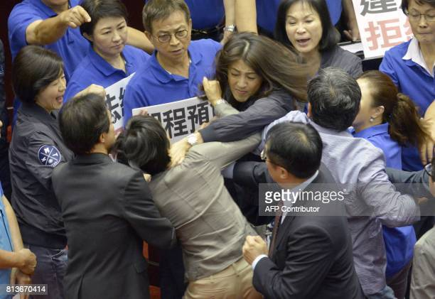 Taiwan's main opposition Kuomintang legislator Hsu Shuhua brawls with ruling Democratic Progressive Party Chu Yiying during a review of a major...