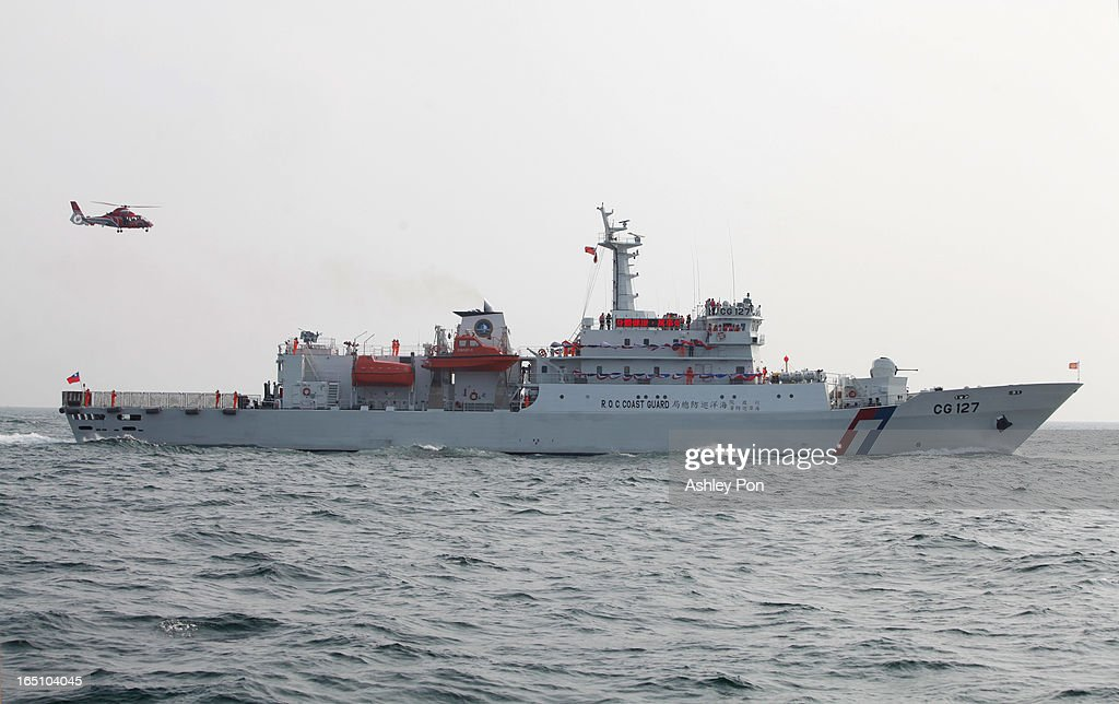 Taiwan's new Xin Bei patrol ship and AS 365 heliporter are seen leaving the port after its commissioning ceremony on March 30, 2013 in Kaohsiung, Taiwan. President Ma Ying-jeou has unveiled two new ships that will patrol the waters off the disputed islands in the East China Sea at the centre of a current regional territorial row.