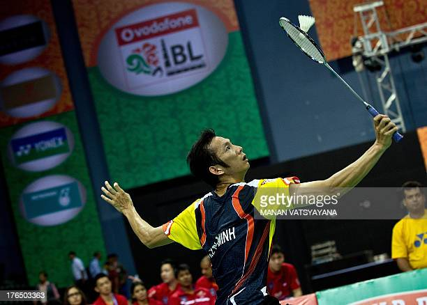 Taiwan's Nyugen Tien Minh of Pune Pistons returns a shot against India's Sai Praneeth of Delhi Smashers during an Indian Badminton League match at...