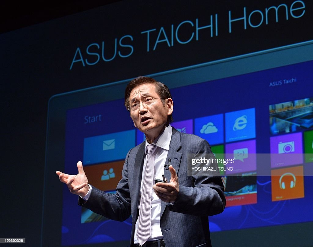 Taiwan's personal computer giant ASUS chairman Honney Shih announces the world's first dual screens notebook computer 'Taichi', which has 11.6-inch LCD display on the both side, enabling to use as a tablet and notebook computer in Tokyo on November 14, 2012. The unique PC, equipped with Intel's Core i7 processor on its CPU will go on sale December 8. AFP PHOTO / Yoshikazu TSUNO