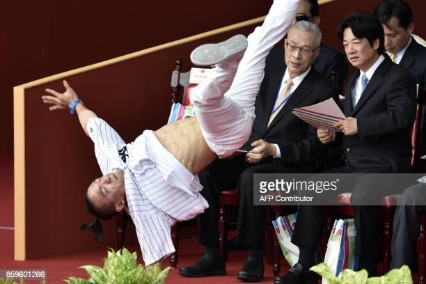 Taiwan's Premier William Lai and main opposition Kuomintang chairman Wu Dunyih watch a performance during the National Day ceremony in Taipei on...