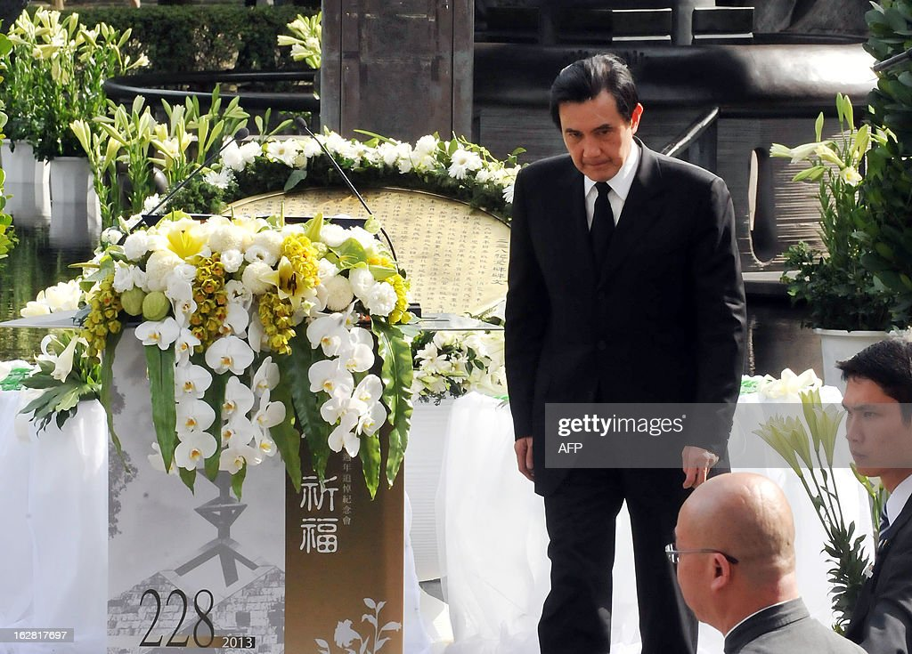 Taiwan's President Ma Ying-jeou speaks to relatives and family members of thousands of people killed by Chinese nationalist troops 66 years ago, during a solemn ceremony held in Taipei on February 28, 2013. On behalf of his government, Ma apologised to the families and relatives of the victims. AFP PHOTO / Mandy CHENG