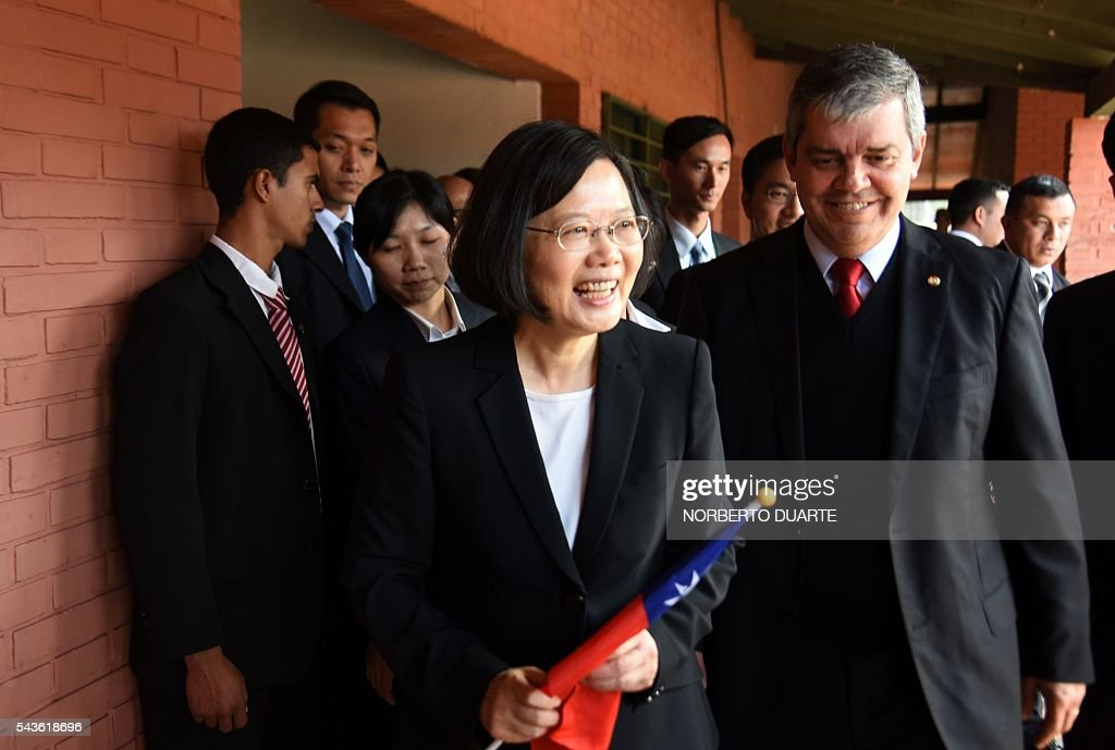 Taiwan's President Tsai Ing-wen, accompanied by Paraguayan Education Minister Enrique Riera (R), visits the General Andres Rodriguez school to which the country donated computers, in Asuncion on June 29, 2016. Taiwan's new president is visiting Paraguay as part of her first overseas trip since taking office in May. / AFP / NORBERTO