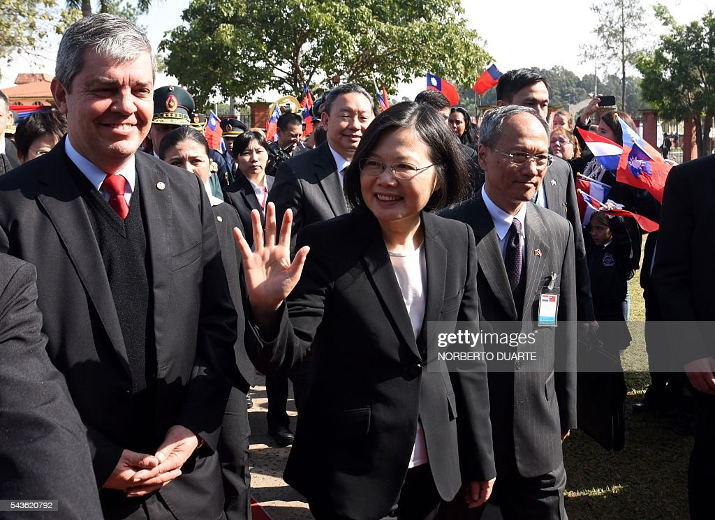 Taiwan's President Tsai Ing-wen (C), accompanied by Paraguayan Education Minister Enrique Riera (L), visits the General Andres Rodriguez school to which the country donated computers, in Asuncion on June 29, 2016. Taiwan's new president is visiting Paraguay as part of her first overseas trip since taking office in May. / AFP / NORBERTO