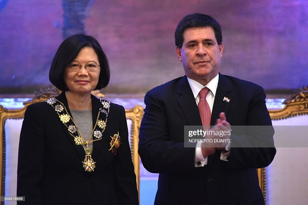 Taiwan's President Tsai Ing-wen (L) is pictured after being decorated by Paraguayan President Horacio Cartes with the Marshal Francisco Solano Lopez Honour Medal, during a ceremony at the presidential palace in Asuncion on June 28, 2016. Taiwan's new president is visiting Paraguay as part of her first overseas trip since taking office in May. / AFP / NORBERTO