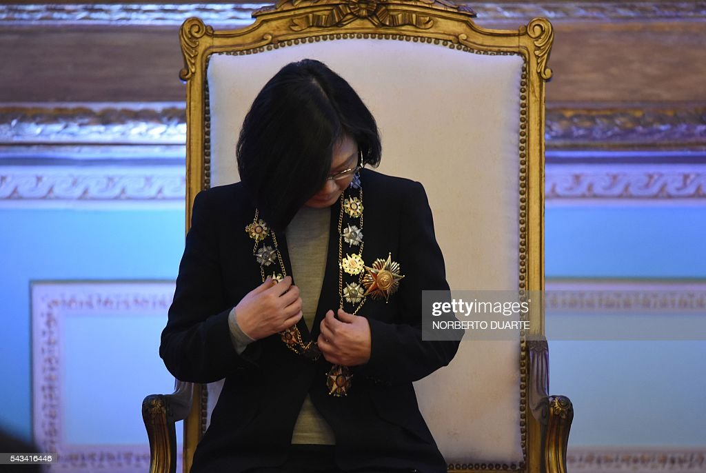 Taiwan's President Tsai Ing-wen is pictured after being decorated by Paraguayan President Horacio Cartes (out of frame) with the Marshal Francisco Solano Lopez Honour Medal, during a ceremony at the presidential palace in Asuncion on June 28, 2016. Taiwan's new president is visiting Paraguay as part of her first overseas trip since taking office in May. / AFP / NORBERTO