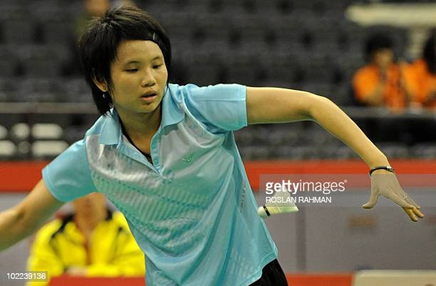 Taiwan's Tai Tzu Ying plays returns against India's Saina Nehwal during a women's singles final of the Singapore Open Super Series 2010 Badminton...