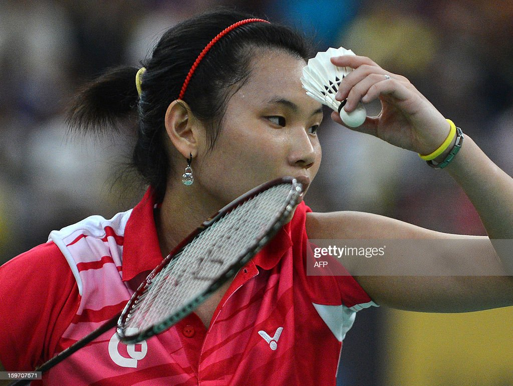 Taiwan's Tai Tzu Ying prepares to serve against India's Saina Nehwal during their woman's singles semi-final match at the Malaysia Open Badminton Superseries in Kuala Lumpur on January 19, 2013.