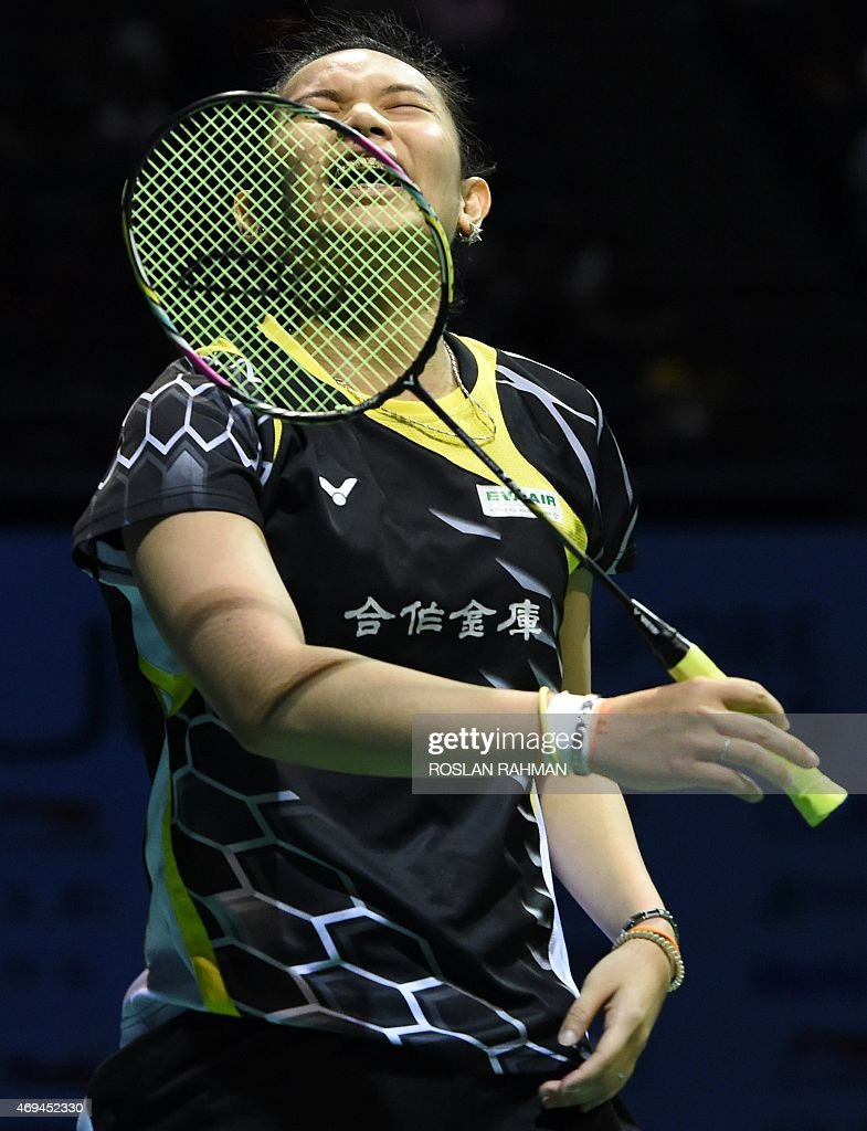 Taiwan's <a gi-track='captionPersonalityLinkClicked' href=/galleries/search?phrase=Tai+Tzu+Ying&family=editorial&specificpeople=7058950 ng-click='$event.stopPropagation()'>Tai Tzu Ying</a> reacts while playing against China's Sun Yu during their women's singles final at the Singapore Open badminton tournament on April 12, 2015.