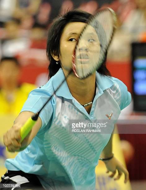 Taiwan's Tai Tzu Ying returns against India's Saina Nehwal during a women's single final of the Singapore Open Super Series 2010 Badminton tournament...