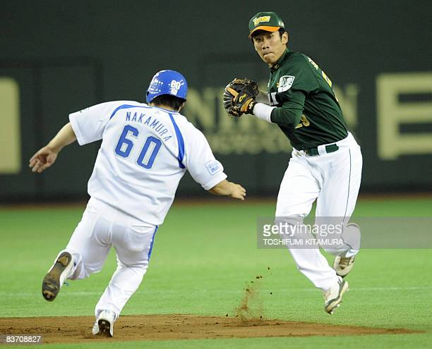 Taiwan's UniPresident 7Eleven Lions shortstop Chuan ChinHer throws the ball to get the double after forcing out Japan's Saitama Seibu Lions third...