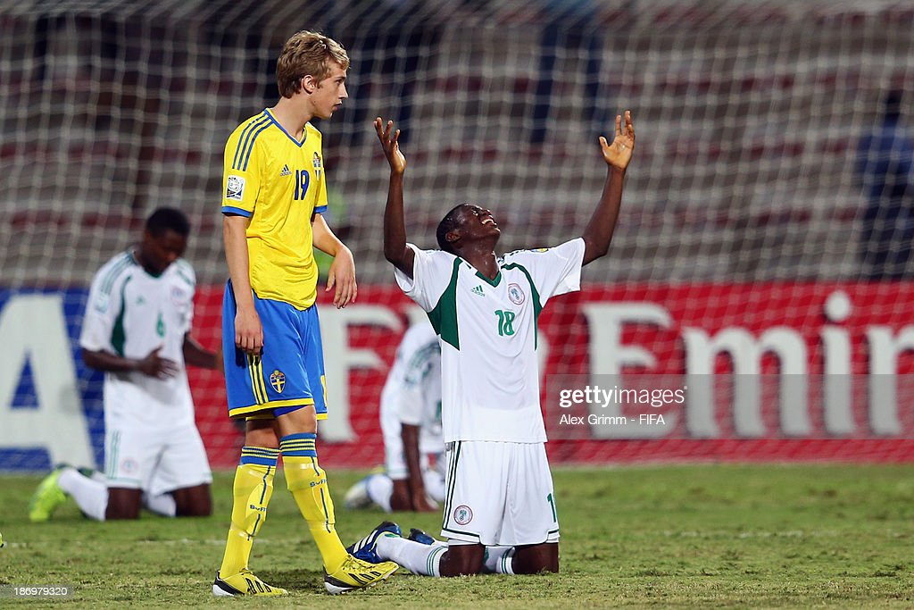 Taiwo Awoniyi of Nigeria celebrates as Linus Fridolf of Sweden walks by after the FIFA U-17 World Cup UAE 2013 Semi Final match between Sweden and Nigeria at Al Rashid Stadium on November 5, 2013 in Dubai, United Arab Emirates.