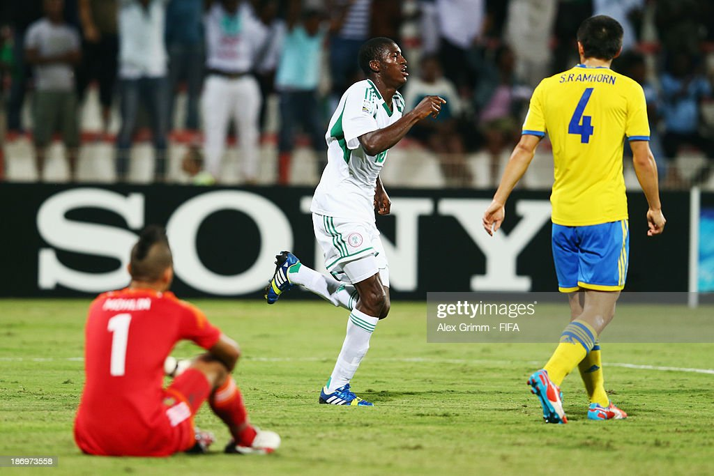 Taiwo Awoniyi of Nigeria celebrates his team's first goal as goalkeeper Sixten Mohlin and Sebastian Ramhorn of Sweden react during the FIFA U-17 World Cup UAE 2013 Semi Final match between Sweden and Nigeria at Al Rashid Stadium on November 5, 2013 in Dubai, United Arab Emirates.