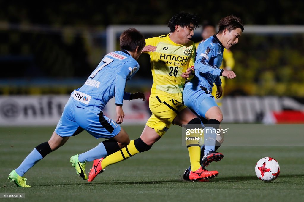 Taiyo Koga (C) of Kashiwa Reysol competes for the ball against Shintaro Kurumaya (L) and Kyohei Noborizato (R) of Kawasaki Frontale during the J.League J1 match between Kawasaki Frontale and Kashiwa Reysol at Todoroki Stadium on March 10, 2017 in Kawasaki, Kanagawa, Japan.