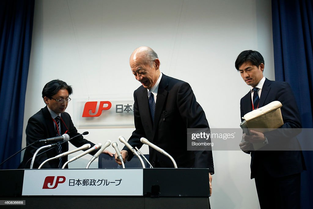 <a gi-track='captionPersonalityLinkClicked' href=/galleries/search?phrase=Taizo+Nishimuro&family=editorial&specificpeople=794998 ng-click='$event.stopPropagation()'>Taizo Nishimuro</a>, president of Japan Post Holdings Co., center, arrives for a news conference in Tokyo, Japan, on Friday, Dec. 26, 2014. Japan's government plans to split Japan Post into three listed companies by selling shares to the public in August or later as it privatizes the nation's biggest consumer bank. Photographer: Kiyoshi Ota/Bloomberg via Getty Images