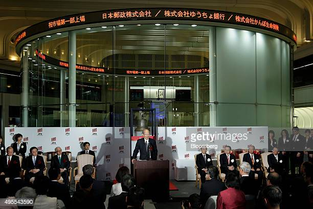 Taizo Nishimuro president of Japan Post Holdings Co center speaks during a ceremony to launch the company's listing on the Tokyo Stock Exchange in...