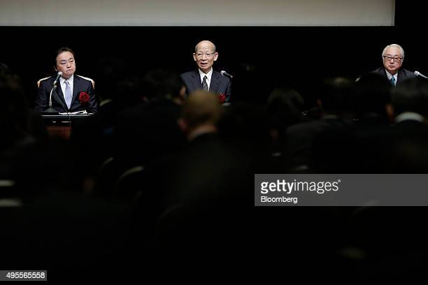 Taizo Nishimuro president of Japan Post Holdings Co center speaks as Masami Ishii president of Japan Post Insurance Co left and Masatsugu Nagato...