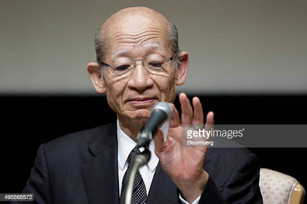Taizo Nishimuro president of Japan Post Holdings Co checks his microphone during a news conference following the company's listing on the Tokyo Stock...