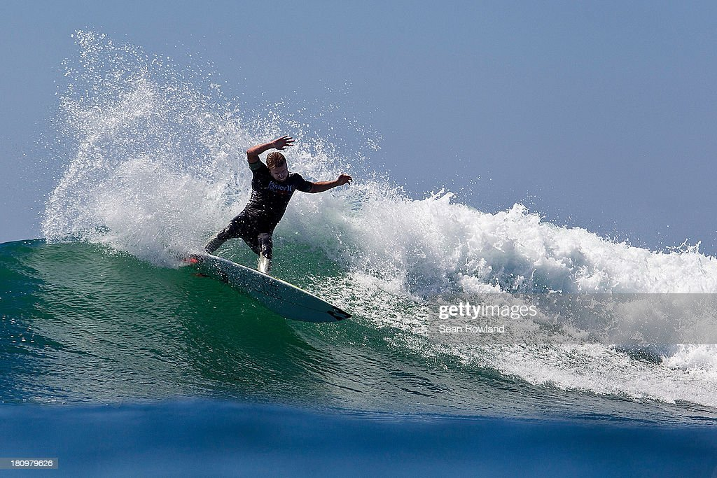 <a gi-track='captionPersonalityLinkClicked' href=/galleries/search?phrase=Taj+Burrow&family=editorial&specificpeople=544765 ng-click='$event.stopPropagation()'>Taj Burrow</a> of Australia surfs during the semifinals at The Hurley Pro on September 18, 2013 in San Diego, California.