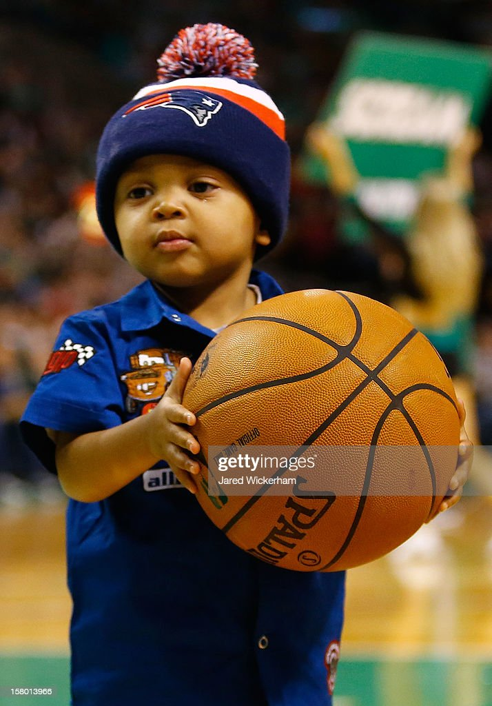 Taj Chung, the son of Patrick Chung #27 of the New England Patriots, holds the basketball during the game between the Boston Celtics and the Philadelphia 76ers on December 8, 2012 at TD Garden in Boston, Massachusetts.