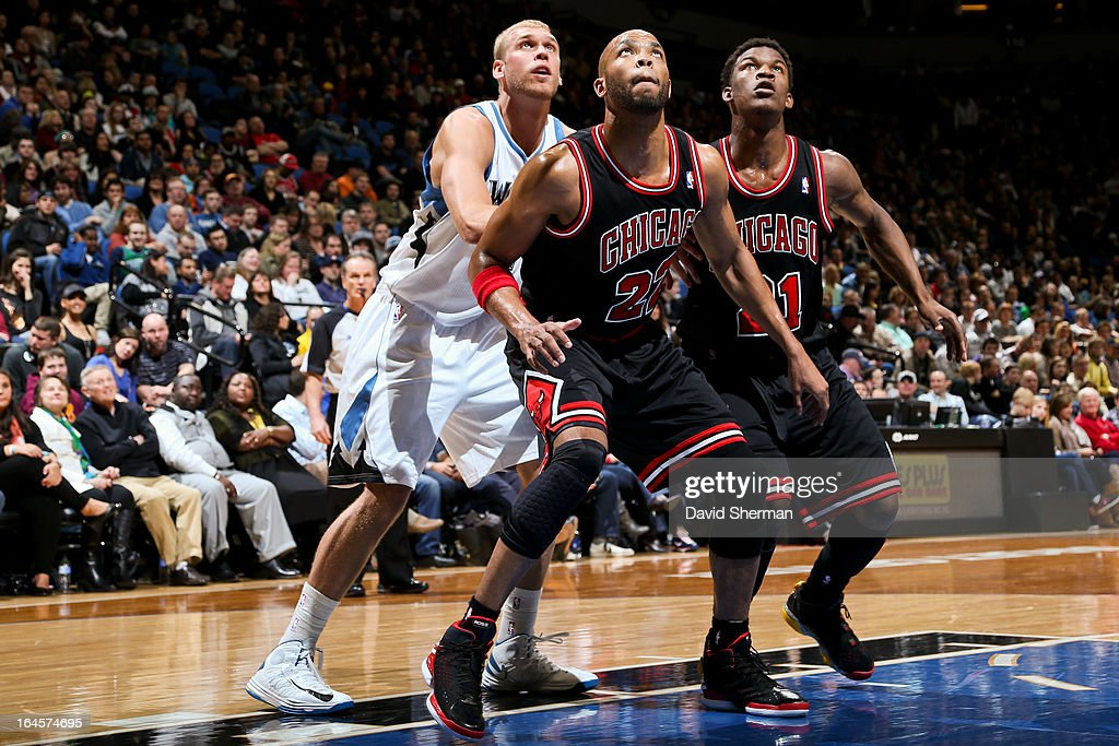 Taj Gibson and Jimmy Butler of the Chicago Bulls battle for rebound position against Greg Stiemsma of the Minnesota Timberwolves on March 24 2013 at...