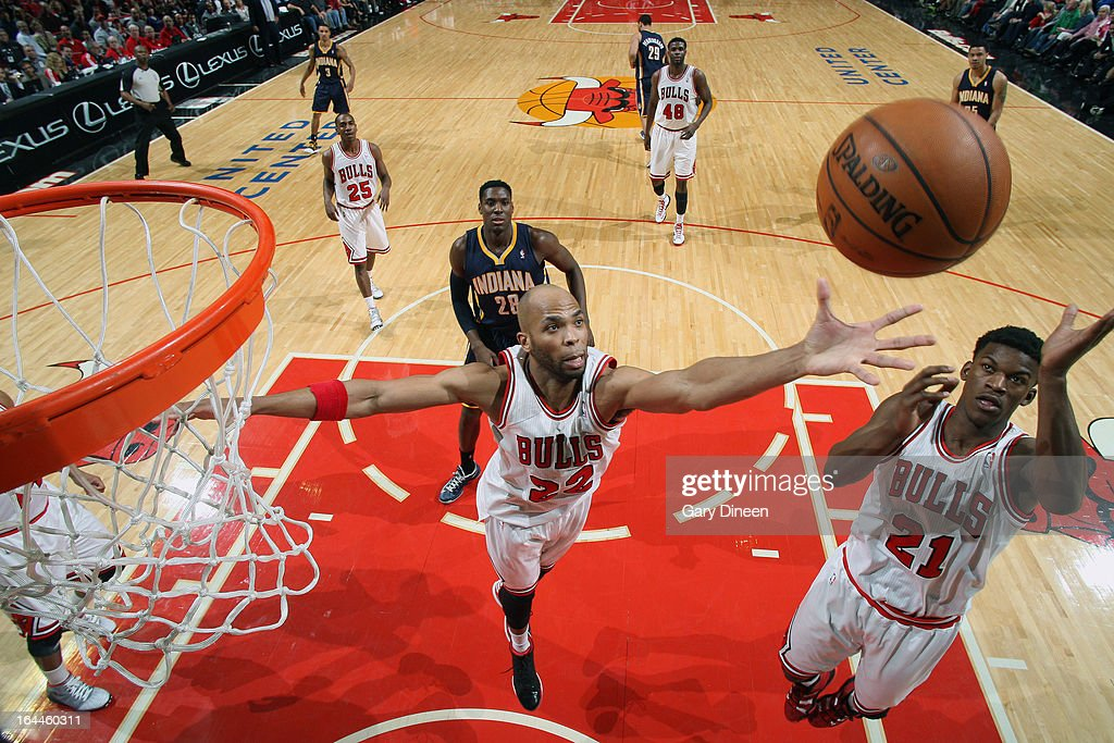 <a gi-track='captionPersonalityLinkClicked' href=/galleries/search?phrase=Taj+Gibson&family=editorial&specificpeople=4029461 ng-click='$event.stopPropagation()'>Taj Gibson</a> #22 and <a gi-track='captionPersonalityLinkClicked' href=/galleries/search?phrase=Jimmy+Butler+-+Basketball+Player&family=editorial&specificpeople=9860567 ng-click='$event.stopPropagation()'>Jimmy Butler</a> #21 of the Chicago Bulls go for a rebound during the game against the Indiana Pacers on March 23, 2013 at the United Center in Chicago, Illinois.