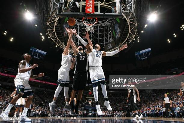 Taj Gibson and Nemanja Bjelica of the Minnesota Timberwolves block the shot against Joffrey Lauvergne of the San Antonio Spurs on November 15 2017 at...