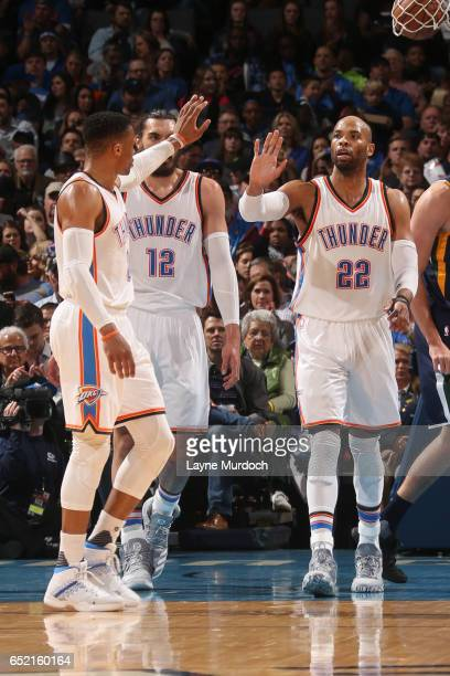Taj Gibson and Russell Westbrook of the Oklahoma City Thunder highfive during a game against the Utah Jazz on March 11 2017 at Chesapeake Energy...