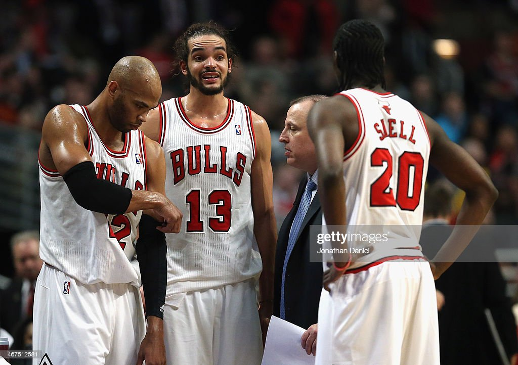 <a gi-track='captionPersonalityLinkClicked' href=/galleries/search?phrase=Taj+Gibson&family=editorial&specificpeople=4029461 ng-click='$event.stopPropagation()'>Taj Gibson</a> #22, <a gi-track='captionPersonalityLinkClicked' href=/galleries/search?phrase=Joakim+Noah&family=editorial&specificpeople=699038 ng-click='$event.stopPropagation()'>Joakim Noah</a> #13 and <a gi-track='captionPersonalityLinkClicked' href=/galleries/search?phrase=Tony+Snell&family=editorial&specificpeople=7551553 ng-click='$event.stopPropagation()'>Tony Snell</a> #20 of the Chicago Bulls listen to head coach <a gi-track='captionPersonalityLinkClicked' href=/galleries/search?phrase=Tom+Thibodeau&family=editorial&specificpeople=2162261 ng-click='$event.stopPropagation()'>Tom Thibodeau</a> during a time out against the Los Angeles Clippers at the United Center on January 24, 2014 in Chicago, Illinois. The Clippers defeated the Bulls 112-95.