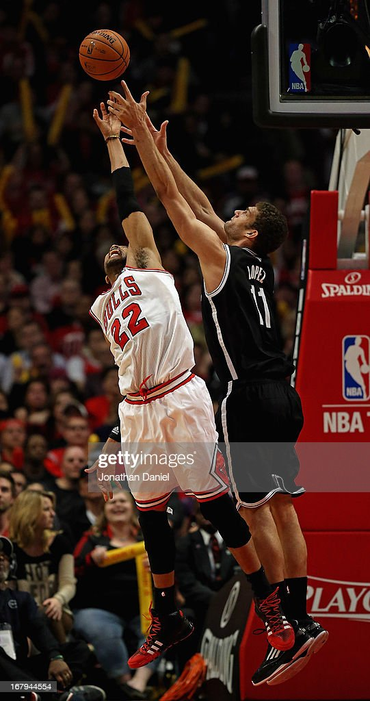 Taj Gibson #22 of the Chicago Bulls and Brook Lopez #11 of the Brooklyn Nets battle for a rebound in Game Six of the Eastern Conference Quarterfinals during the 2013 NBA Playoffs at the United Center on May 2, 2013 in Chicago, Illinois. The Nets defeated the Bulls 95-92.