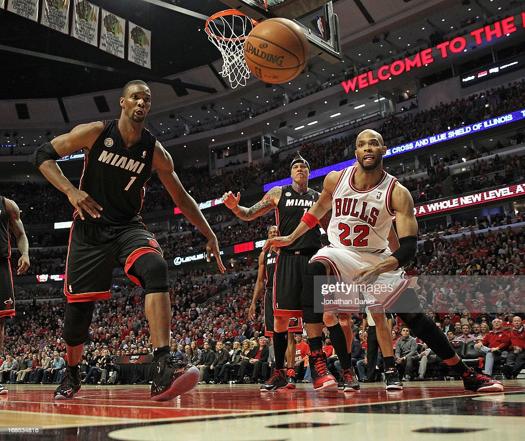 <a gi-track='captionPersonalityLinkClicked' href=/galleries/search?phrase=Taj+Gibson&family=editorial&specificpeople=4029461 ng-click='$event.stopPropagation()'>Taj Gibson</a> #22 of the Chicago Bulls and <a gi-track='captionPersonalityLinkClicked' href=/galleries/search?phrase=Chris+Bosh&family=editorial&specificpeople=201574 ng-click='$event.stopPropagation()'>Chris Bosh</a> #1 of the Miami Heat watch as the ball sails out of bounds in Game Three of the Eastern Conference Semifinals during the 2013 NBA Playoffs at the United Center on May 10, 2013 in Chicago, Illinois. The Heat defeated the Bulls 104-94.