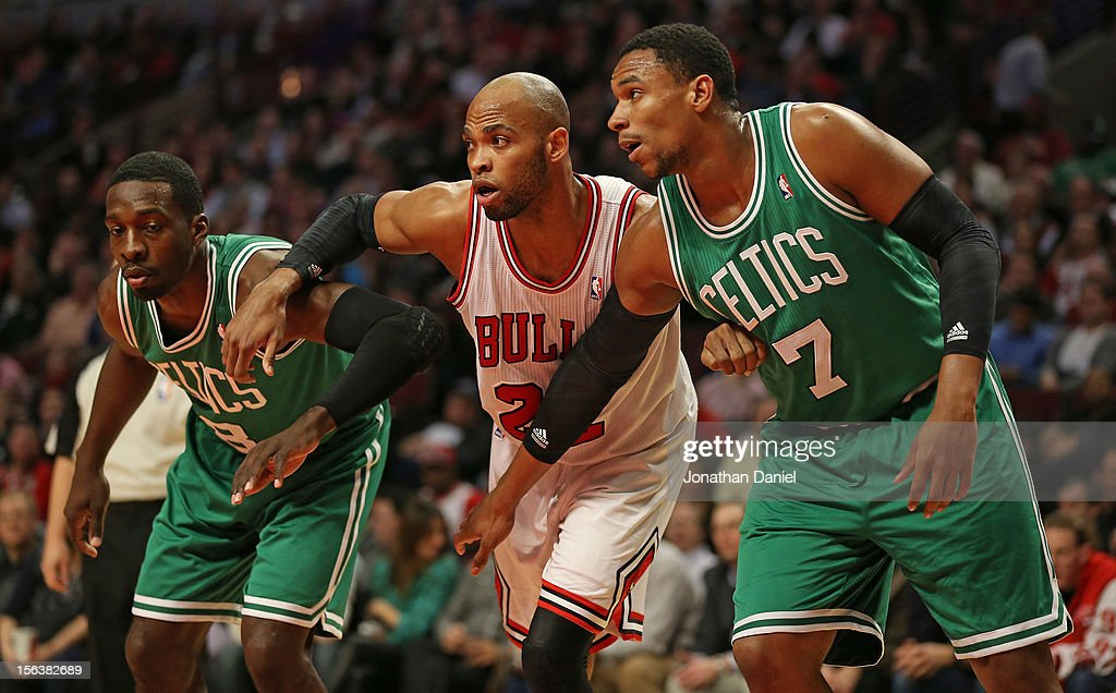 Taj Gibson #22 of the Chicago Bulls and Jeff Green #8 and Jared Sullinger #7 of the Boston Celtics jockey for position during a free-throw at the United Center on November 12, 2012 in Chicago, Illinois. The Celtics defeated the Bulls 101-95.