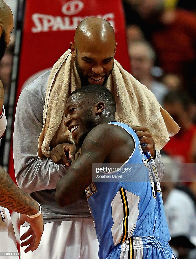 <a gi-track='captionPersonalityLinkClicked' href=/galleries/search?phrase=Taj+Gibson&family=editorial&specificpeople=4029461 ng-click='$event.stopPropagation()'>Taj Gibson</a> #22 of the Chicago Bulls and <a gi-track='captionPersonalityLinkClicked' href=/galleries/search?phrase=Nate+Robinson&family=editorial&specificpeople=208906 ng-click='$event.stopPropagation()'>Nate Robinson</a> #10 of the Denver Nuggets share a laugh and a hug after a preseason game at the United Center on October 25, 2013 in Chicago, Illinois. The Bulls defeated the Nuggets 94-89.