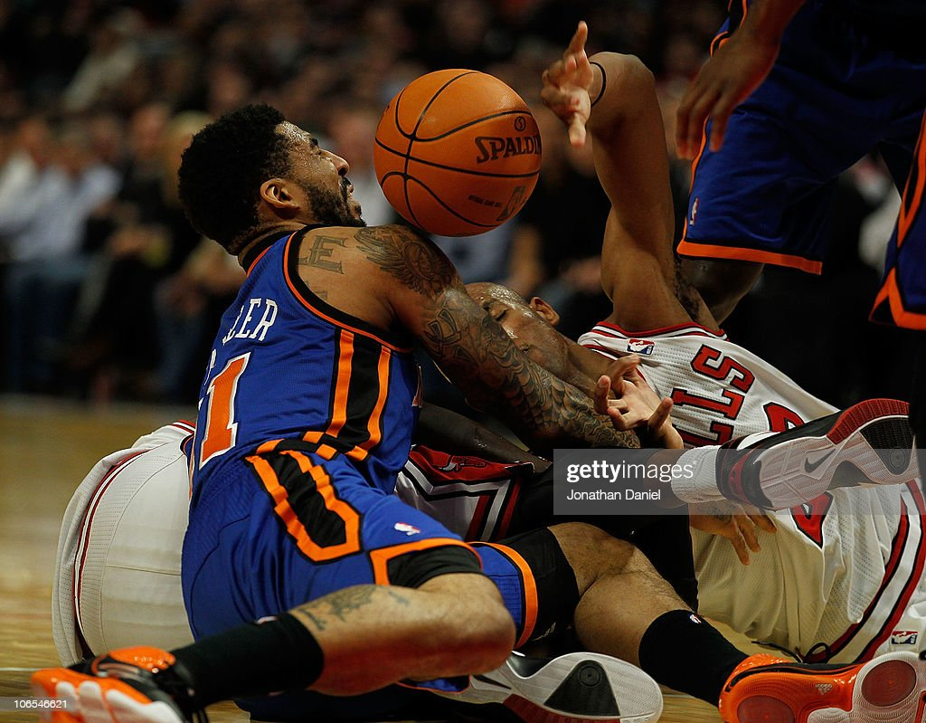 Taj Gibson of the Chicago Bulls and Wilson Chandler of the New York Knicks battle for a loose ball at the United Center on November 4 2010 in Chicago...