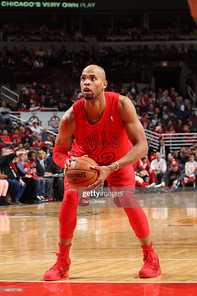 Taj Gibson #22 of the Chicago Bulls attempts a foul shot against the Houston Rockets during a Christmas Day game on December 25, 2012 at the United Center in Chicago, Illinois.