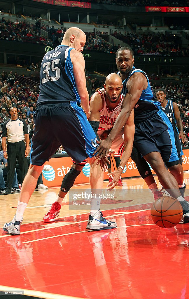 <a gi-track='captionPersonalityLinkClicked' href=/galleries/search?phrase=Taj+Gibson&family=editorial&specificpeople=4029461 ng-click='$event.stopPropagation()'>Taj Gibson</a> #22 of the Chicago Bulls battles for a loose ball against <a gi-track='captionPersonalityLinkClicked' href=/galleries/search?phrase=Elton+Brand&family=editorial&specificpeople=201501 ng-click='$event.stopPropagation()'>Elton Brand</a> #42 and <a gi-track='captionPersonalityLinkClicked' href=/galleries/search?phrase=Chris+Kaman&family=editorial&specificpeople=201661 ng-click='$event.stopPropagation()'>Chris Kaman</a> #35 of the Dallas Maverickson November 28, 2012 at the United Center in Chicago, Illinois.