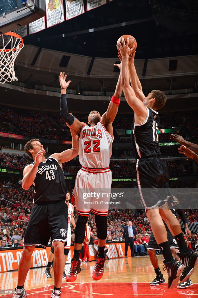 Taj Gibson #22 of the Chicago Bulls battles for a rebound against Kris Humphries #43 and Brook Lopez #11 of the Brooklyn Nets in Game Three of the Eastern Conference Quarterfinals during the 2013 NBA Playoffs on April 25, 2013 at United Center in Chicago, Illinois.