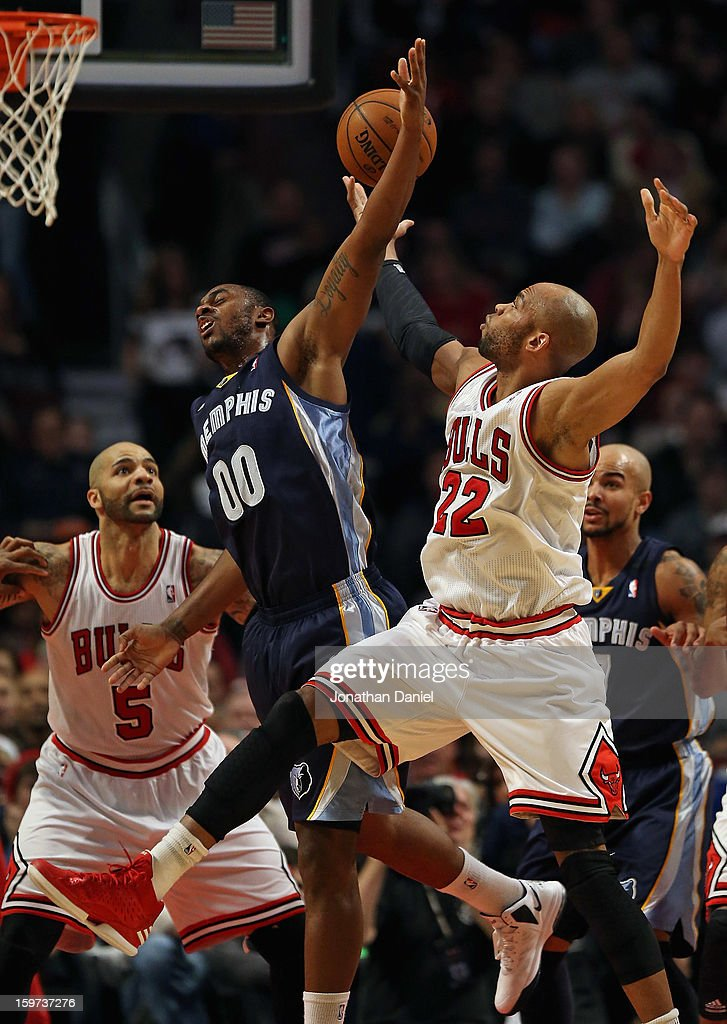 Taj Gibson #20 of the Chicago Bulls battles for a rebound with Darrell Arthur #00 of the Memphis Grizzles at the United Center on January 19, 2013 in Chicago, Illinois.